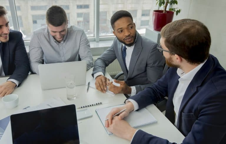 Young multiracial business team working process in office