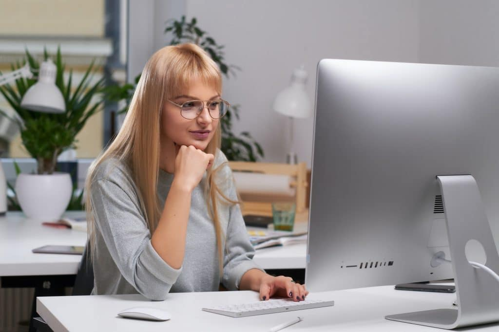 Young woman is working using computer