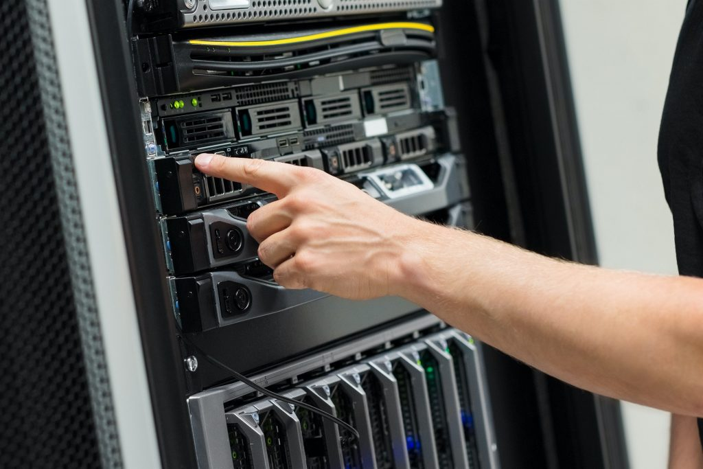 Close-up of IT Engineer Switching On Server At Datacenter